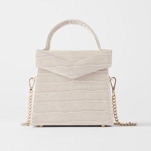 Leather box bag in ecru